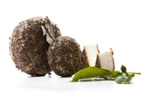 Sheep's cheese preserved in walnut leaves